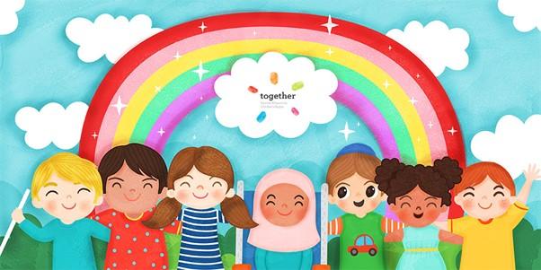 Image of children smiling beneath a rainbow